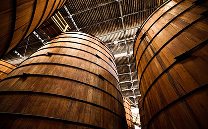 Learn more about the aging process of cachaça in wooden barrels